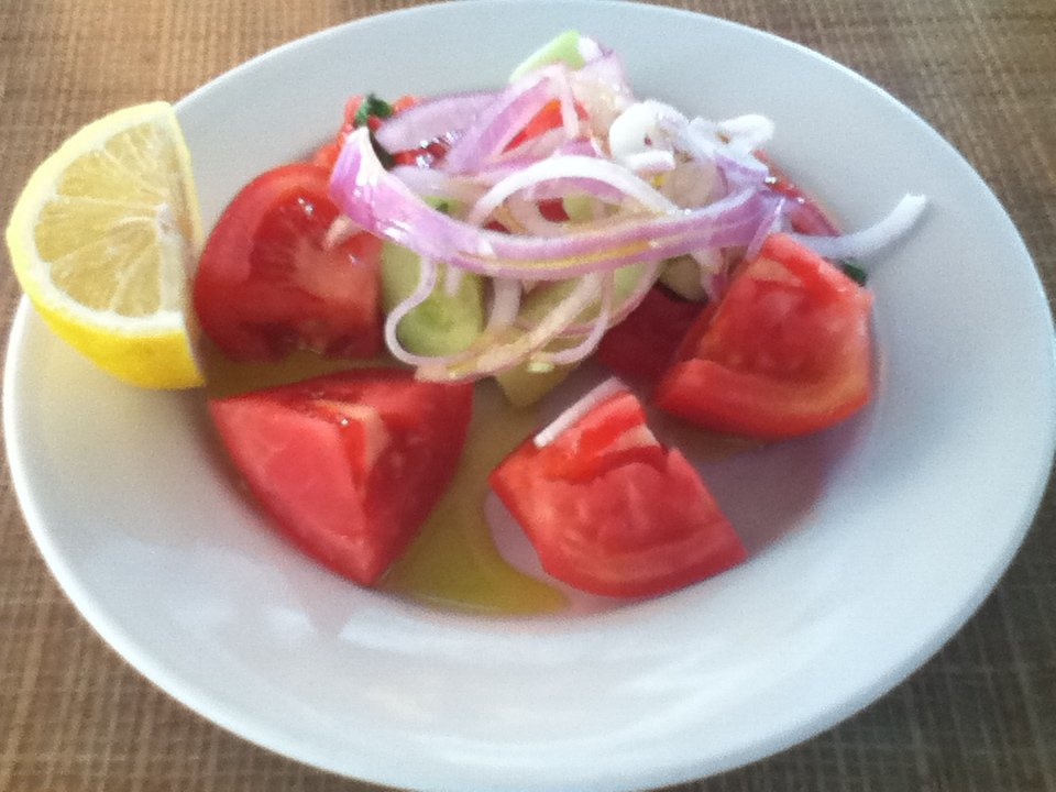 Tomato and onion salad at a truck stop in Greece