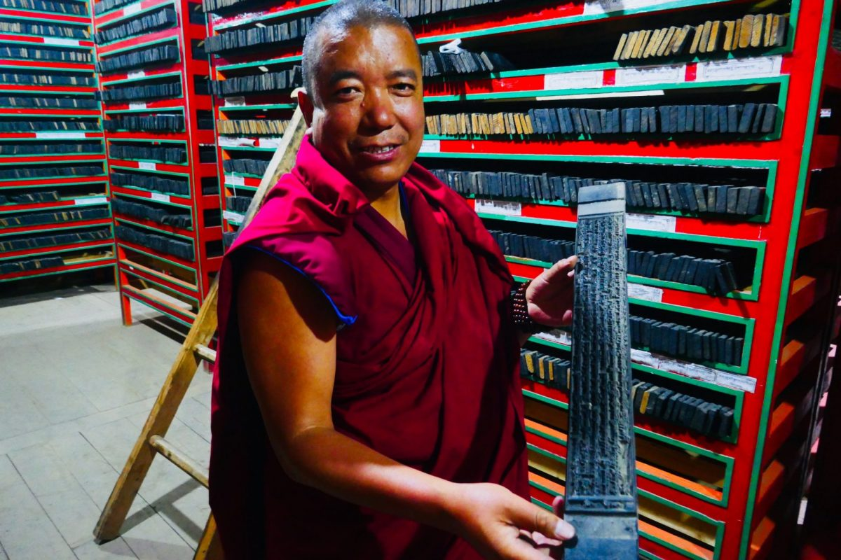 monk at printing house