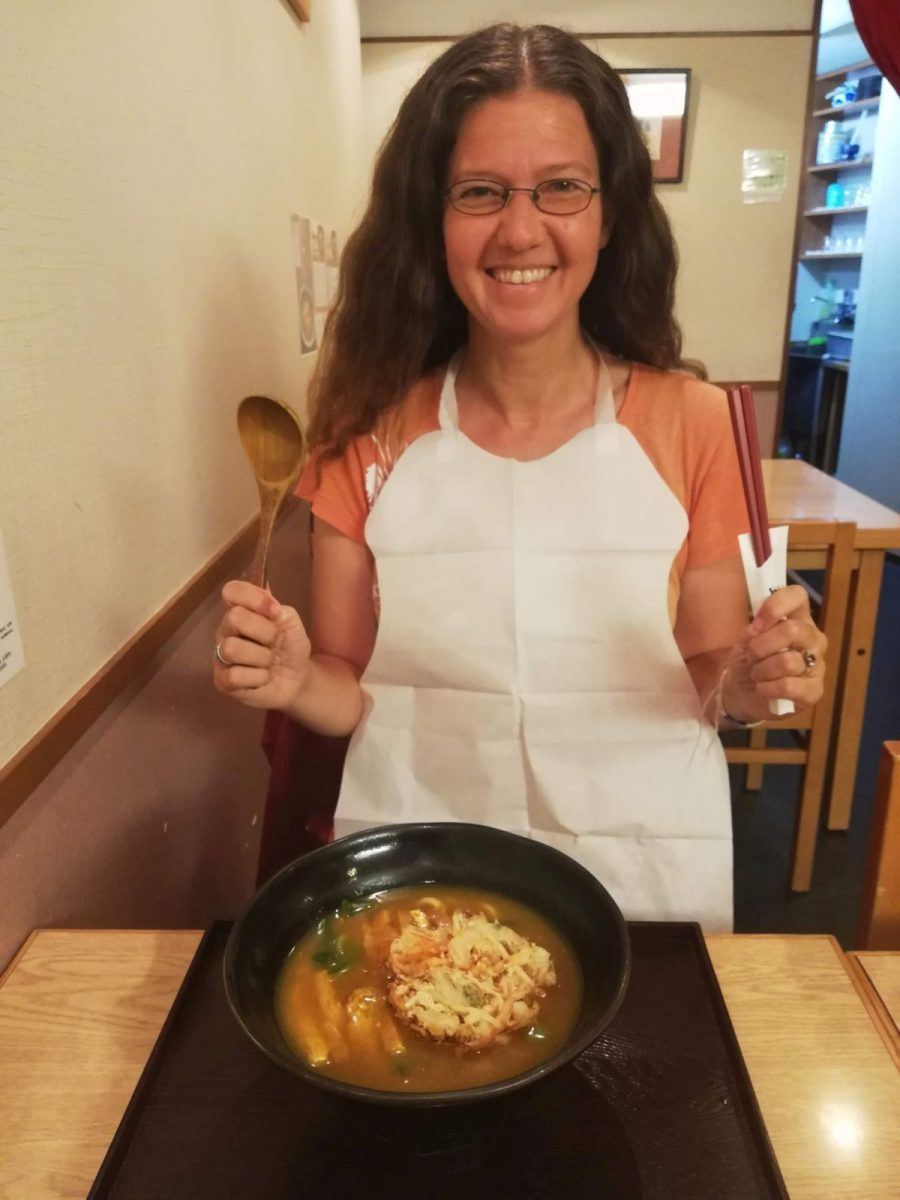 Eating Mimikou udon noodles with a bib