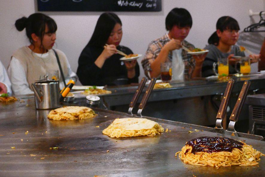 Eating vegan okonomiyaki in Hiroshima