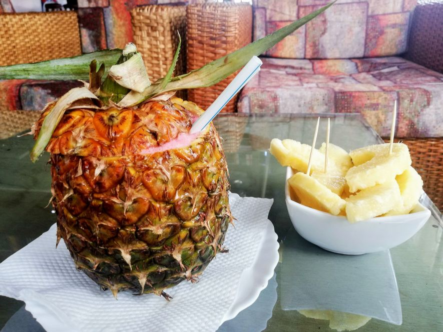 Drinking cocktails out of a pineapple