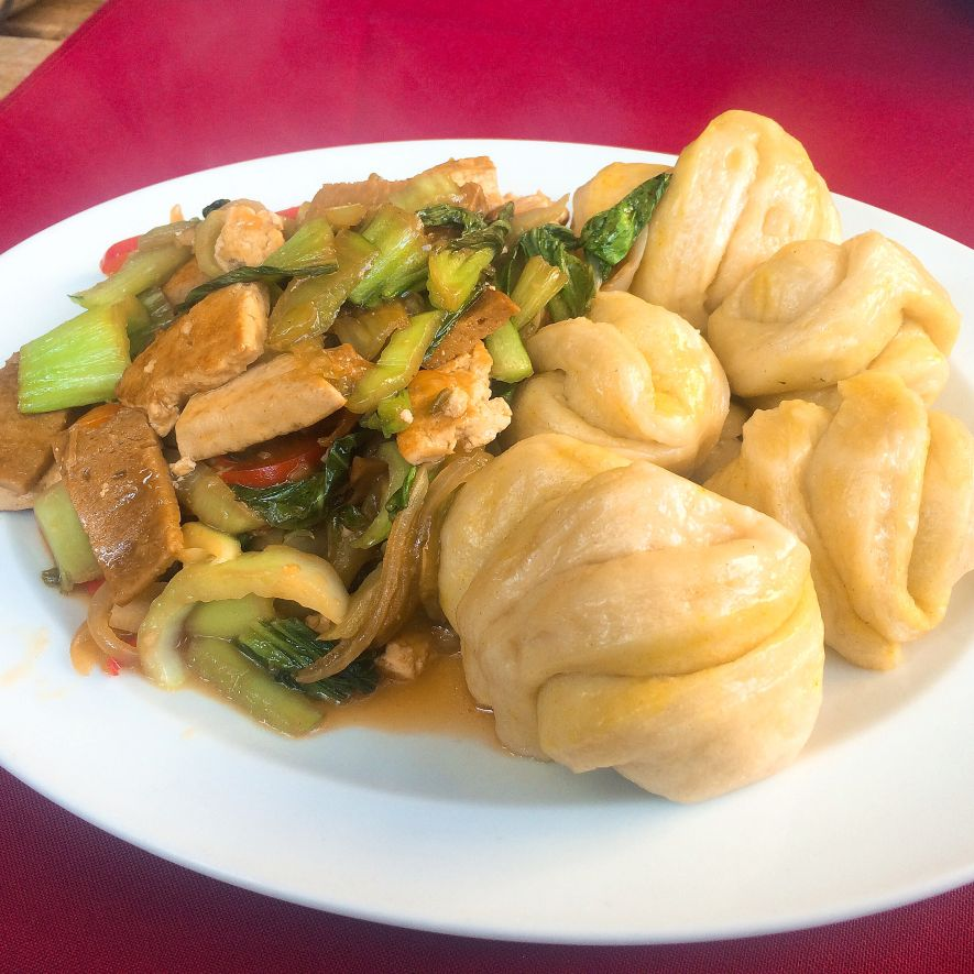 Ting Momos served with vegetables and tofu