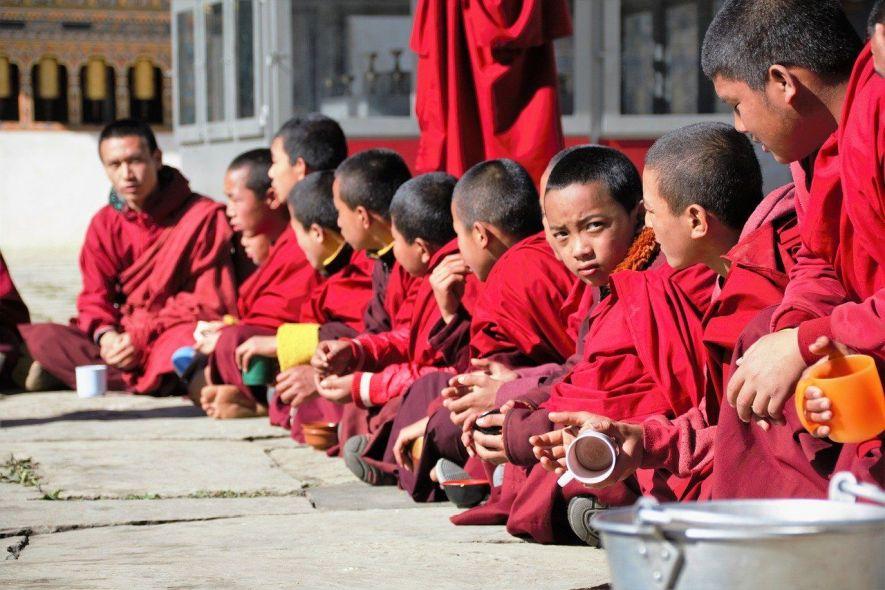 Boy monks drinking tea