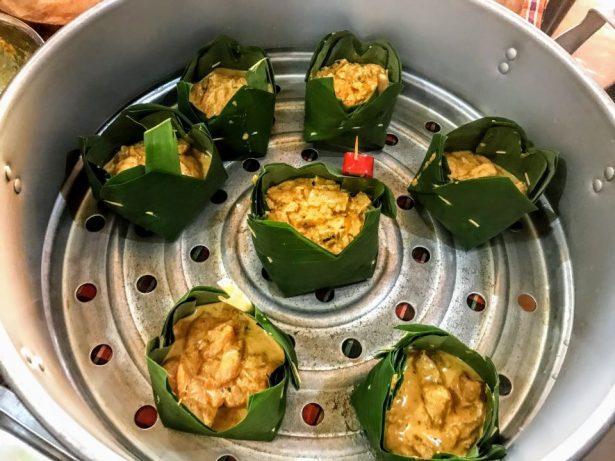 Steaming tofu amok at vegan cookery class in Battambang