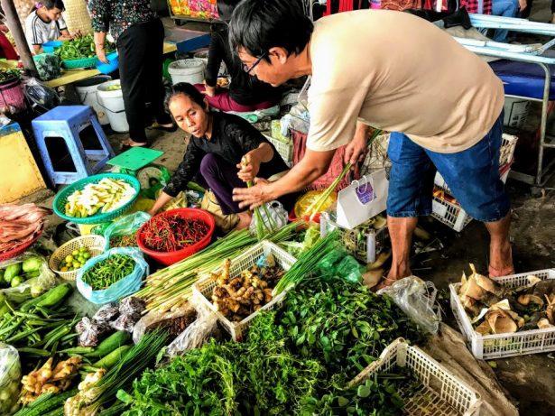 Vegetable seller in Battambang market